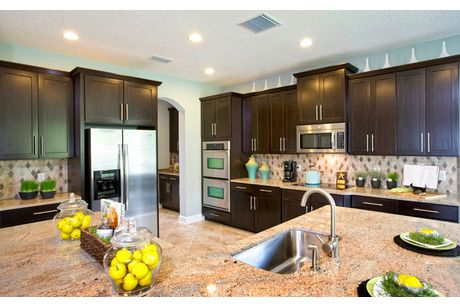 Sleek cabinets with chrome handles. Standard Pacific Homes. Wesley Chapel, FL.