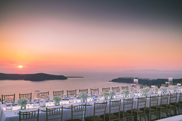 Wedding Reception Dinner @ La Maltese  overlooking the most famous sunset in the world. Wedding In Santorini, Greece by Stella And Moscha