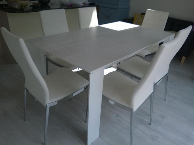 Dining set with our TAVOLE extendable dining table in ceramic top with lines and Hermes dining chair in white. TAVOLE table extends from 160cm to 250cm (Other sizes available on our website). Delivered to our client in London.