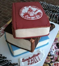 Graduation cake. It seems like the last thing I would want, until we start cutting it up.