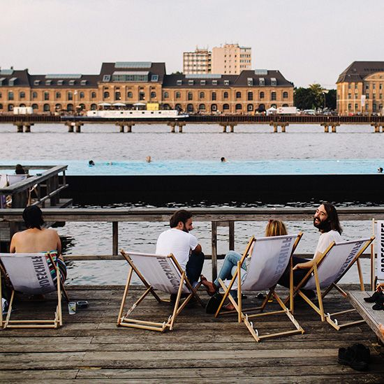Public swimming pool floating in a permanent spot on the Spree River.