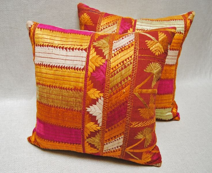 Custom pillows from a vintage Phulkari wedding shawl from Punjab, India with silk embroidery on hand loomed cotton.  Maison Suzanne Gallery