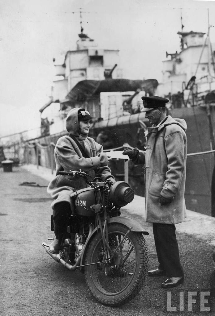 Female dispatch riders, commonly called Wrens, delivers a message on her Royal Enfield, 1941