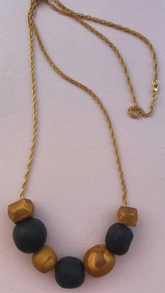 Check out this item in my Etsy shop https://www.etsy.com/listing/399675681/black-gold-handmade-statement-necklace