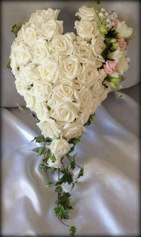 pink flower bouquets for weddings 2 ivory shaped bouquet with a soft pink and green 6580
