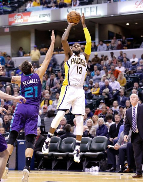 Paul George #13 of the Indiana Pacers shoots the ball during the game against the Charlotte Hornets at Bankers Life Fieldhouse on December 12, 2016 in Indianapolis, Indiana. NOTE TO USER: User expressly acknowledges and agrees that, by downloading and or using this photograph, User is consenting to the terms and conditions of the Getty Images License Agreement