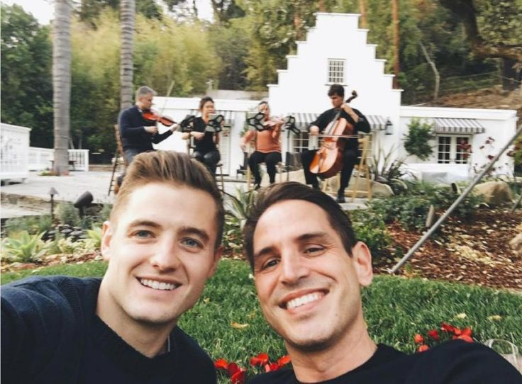 Congratulations are in order for soccer star Robbie Rogers and producer Greg Berlanti — they're engaged! Rogers, who plays for L.A. Galaxy, shared an Instagram post of a the couple posing for a selfie in front of a string quartet. Berlanti — a writer and producer behind shows like Dawson's Creek, Arrow