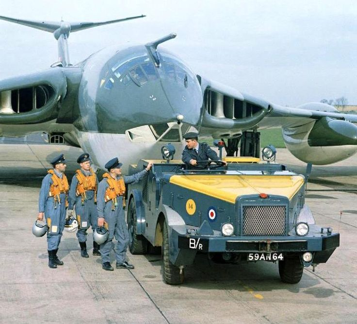 A Handley Page Victor B.2 under tow from an RAF towing truck. The flight crew talk to the driver of the truck.