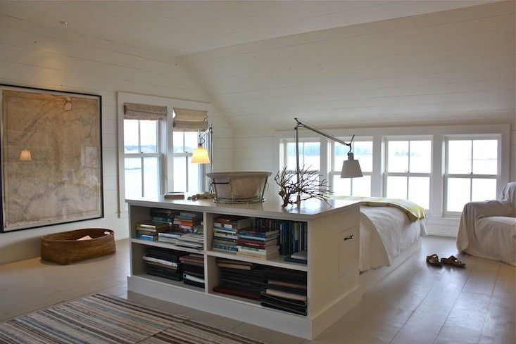 Harbor Cottage in Maine Bedroom with Bed in the middle of the room I Remodelista