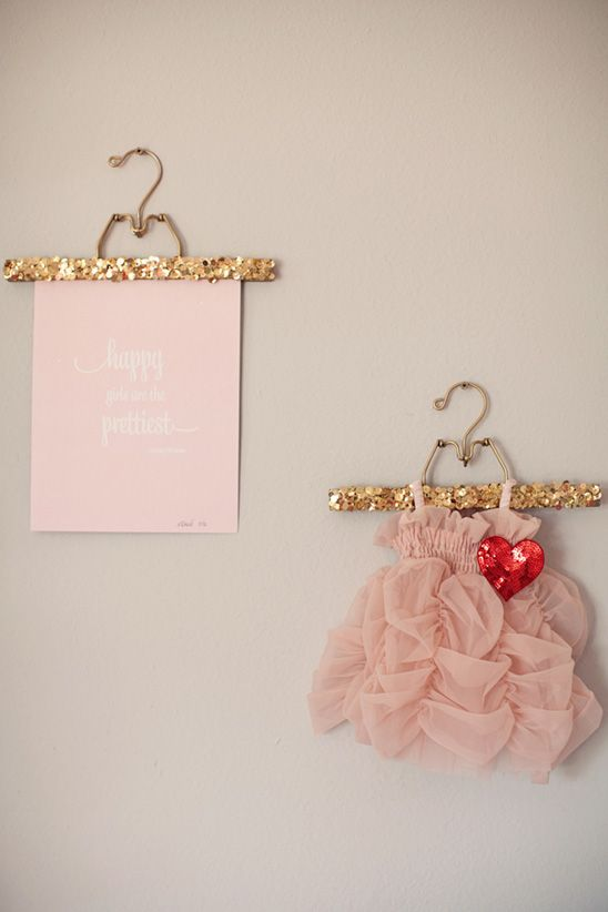 sequined hangers! Adorable baby girl's room.