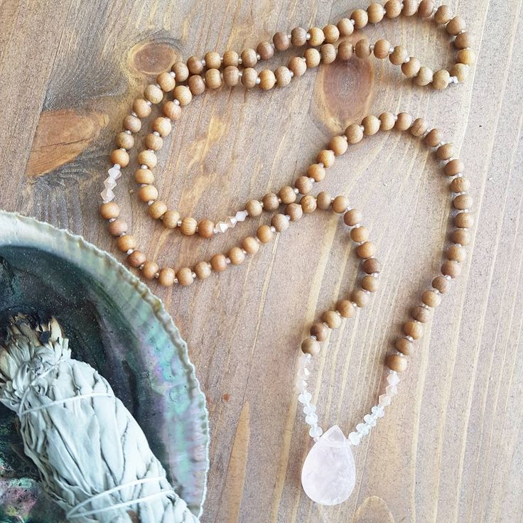 I loved hearing your thoughts as I shared the progress of its design through Instagram stories. The all sandalwood version won out and I absolutely love it! Gorgeous iridescent peach toned spacer beads are hard to see in the photos, but one of my favourite features  As you embark on this new chapter of your life, the Magical Beginnings Mama Mala keeps you in tune with the natural cycles of reflection and growth so you can embrace your new journey with a light and open heart.