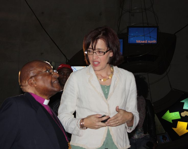 Maropeng marketing manager Lindsay Marshall takes Archbishop Emeritus Desmond Tutu through the interactive exhibition on July 31 2013.