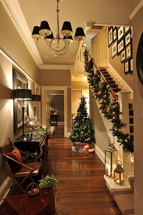 Stunning Christmas Hallway ...love the small tree, garland & lanterns