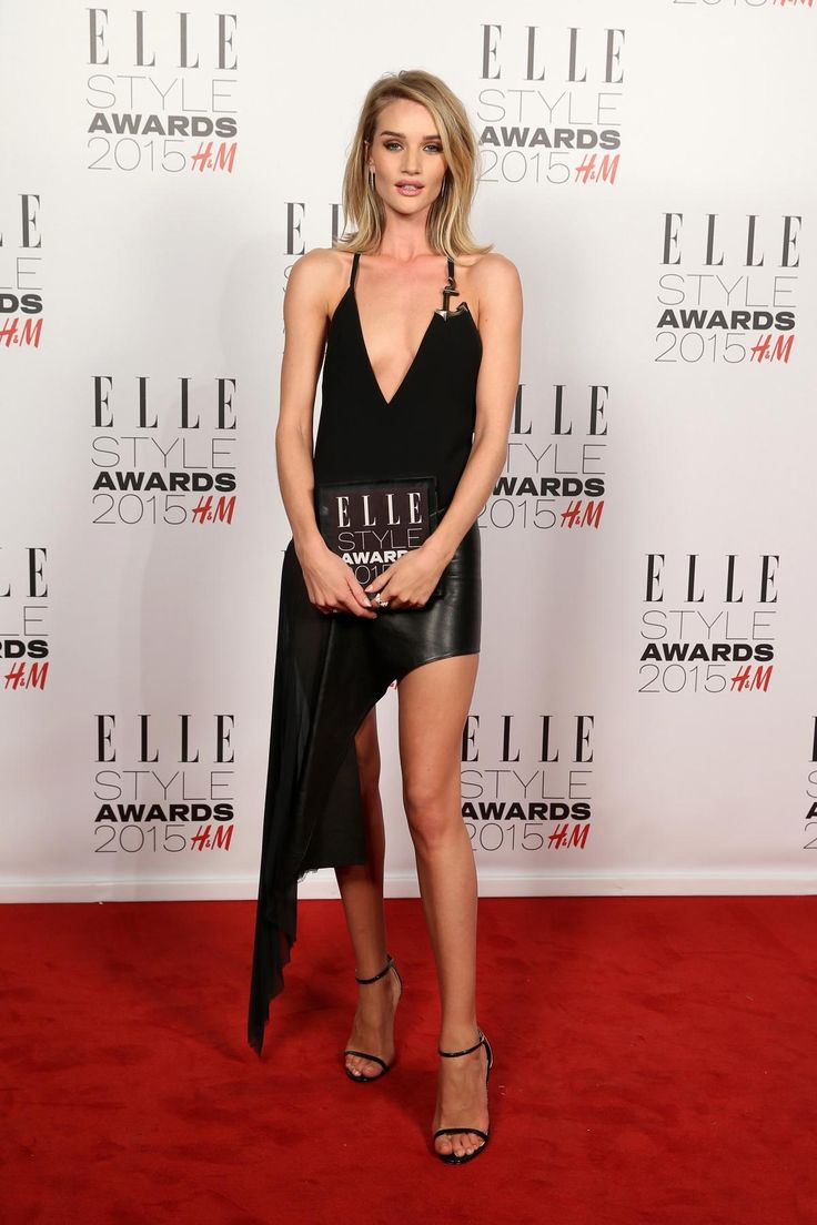 Rosie Huntington Whiteley wearing a sexy black asymmetrical dress at the 2015 Elle Style Awards