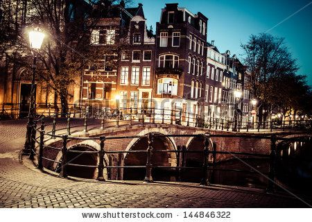 One of the famous canals of Amsterdam, the Netherlands at dusk. by Curioso, via ShutterStock