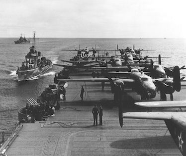 Within 24 hours, 16 of the Army B-25's Mitchell bombers were loaded onto Hornet's flight deck and tied down in the order of their expected launch position USS Hornet (CV-8) #10A