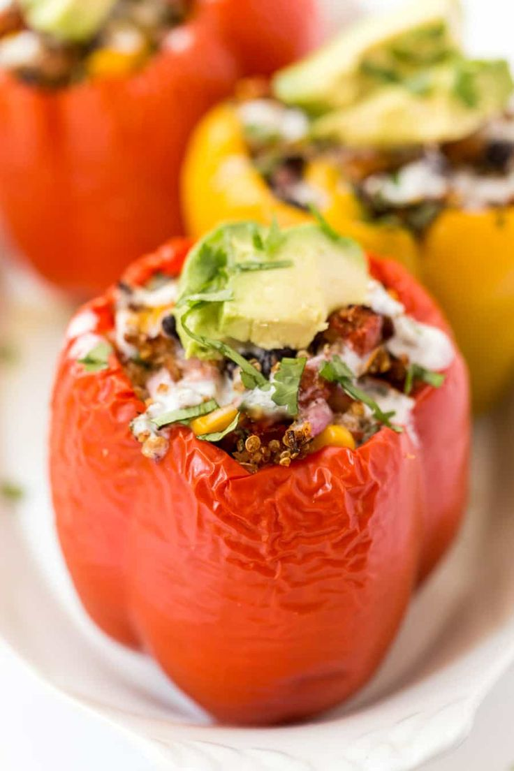 MEXICAN QUINOA STUFFED PEPPERS -- with black beans, corn, tomatoes and topped with avocado!