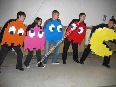 Homemade Pac Man Group Costume: My brother and I made this Pac Man Group Costume from cardboard boxes and spray paint. First we drew a grid of pixels on the cardboard and then traced
