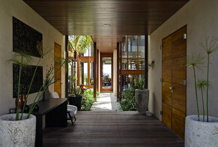 Beach-front Balinese inspired family home in Salt Village, Kingscliff, New South Wales, Australia. Built by Seabreeze Homes. Designed by Grounds Kent Architects