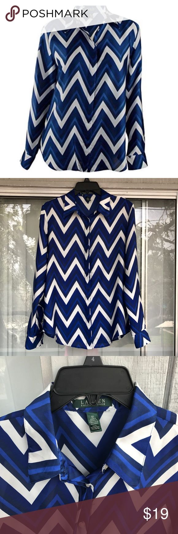 """Ralph Lauren Chevron Print Work Office Shirt M 🔹 Bundle with other work clothes and save 🔹  Crafted from smooth polyester, Lauren Ralph Lauren's lightweight blouse features a trendy chevron print. Great for professional or business casual look over skinny jeans..     Length: 25"""" Color: Cobalt/Navy multi Point collar  Concealed buttoned placket  Long sleeves with buttoned barrel cuffs  Machine wash.    USED Small iron dent - not visible when worn (see last photo) Loose fabric pulling on…"""