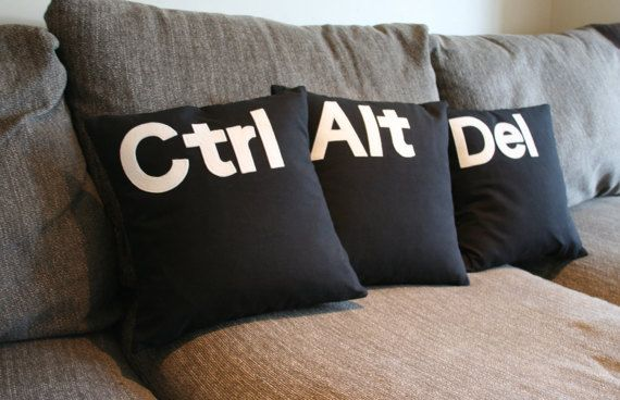 Set of three 16 Ctrl Alt Del cushion covers in medium weight black cotton.  Letters are cut out of felt and appliquéd on by machine.  This item is a unique handmade item, and will be crafted for dispatch within three working days. The back features a pillow opening for ease. To keep postage costs low, please note this is for the covers only, you will require three 16 x 16 inserts.  All of my items are crafted only using high quality fabrics. Seams are overlocked with an industrial serger.  I…
