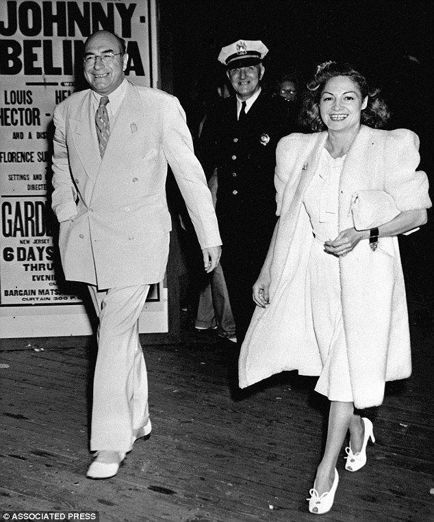 Smooth criminal: Johnson treads the Atlantic City boardwalk with chorus girl Florence Osbeck, right