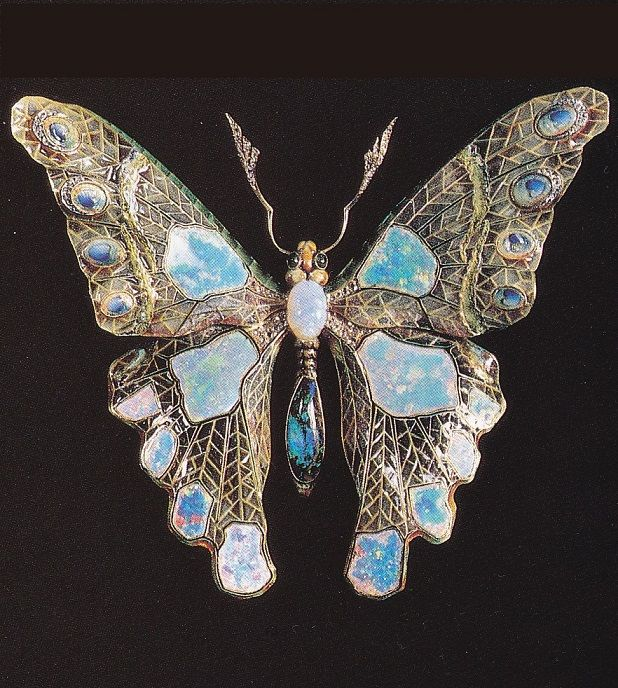 An Art Nouveau butterfly brooch in plique-à-jour enamel, set with opals and diamonds, France, circa 1900. Image source: Art Nouveau Jewelry by Vivienne Becker #ArtNouveau #brooch