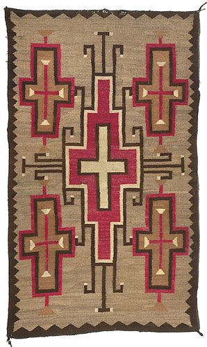 "Navajo .circa 1920-30. Woven in red, cream, natural brown and tan against a medium brown ground with a large central cross, linked with four others at corners of rug; 71"" x 41."""