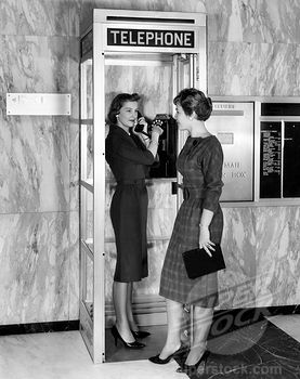 A new model phone booth introduced by Aluminum Company of American made for smaller locations than traditional phone booths, circa 1960s
