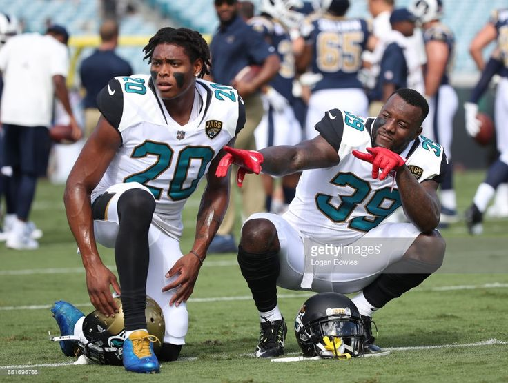 Jalen Ramsey #20 and Tashaun Gipson #39 of the Jacksonville Jaguars wait on the field prior to the start of their game against the Los Angeles Rams at EverBank Field on October 15, 2017 in Jacksonville, Florida.