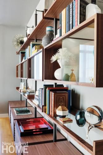 Books And Collections Are Displayed On The Ubiqua Shelving System By Porada Interior Design