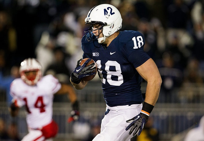 Penn State's Jesse James picks up big yardage after a catch during the Lions 24-21 overtime win at Beaver Stadium.