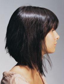 A medium black straight Womens haircut poker-straight hairstyle by Saks