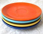 Orange, blue, yellow, and cobalt Fiesta Ware  my mom's original set had green instead of the light blue