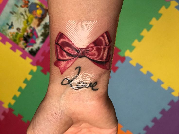 Pink bow tattoo on wrist 🎀 Love SURENO tattoos