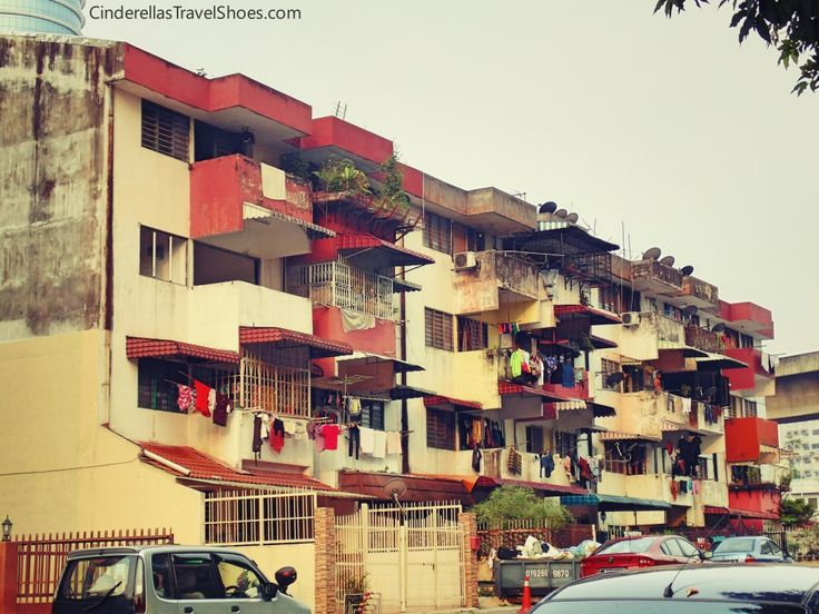 Indian people living in poor condidions next to luxury appartments in Little India, Kuala Lumpur