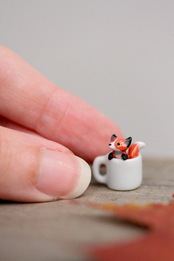 A long time favourite is back in an entirely new version!  The miniature porcelain mug you see is just A THIRD of an inch tall (approx 8mm). Can you imagine how tiny the little fox is?  Every figurine is handsculpted from supersculpey clay, and has the tiniest glass eyes. Each fox is then baked and painted with several layers of acrylics, to achieve perfect coverage and smoothness - and then carefully checked to ensure its cuteness before glazing it. Transparent varnish is applied for…