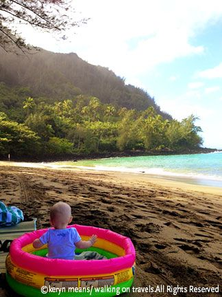 What to do with a baby at the beach.  Tip: Buy a cheap, blow up baby pool to sit your baby in at the beach.