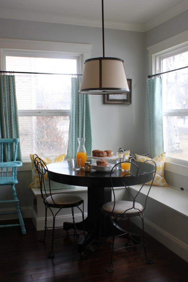 Furniture, Stunning L Shaped White Stained Kitchen Nook Yellow Floral Pattern Cushions Nice Brown Pendant Lamp Round Black Stained Dining Table Black Vintage Dining Chairs With White Cushion White Glass Windows Dark Wood Floor: Knowing Best Kitchen Nook Ideas
