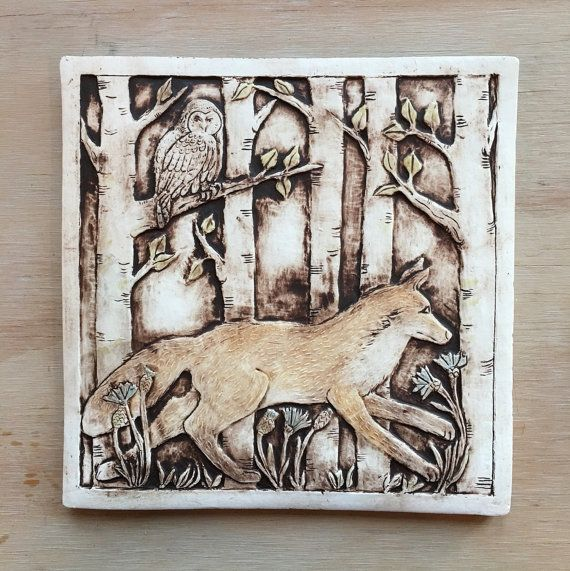 Eight inch porcelain tile featuring an original design of a running for with a owl looking on. May be hung as wall decor or used in an installation. A hook is attached for easy hanging.