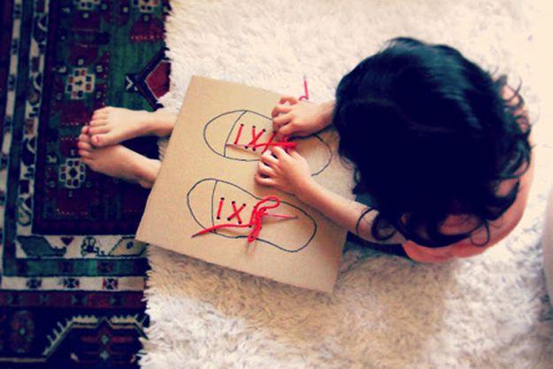 Cardboard to teach shoe-tying...