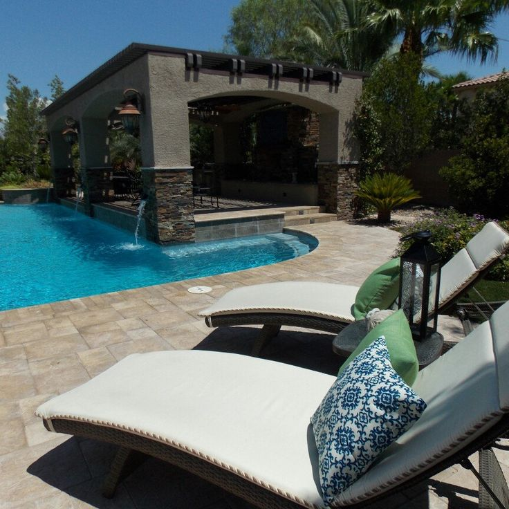 Poolside patio chaise lounge chairs with our luxurious outdoor blue and green pillow covers. Ready to relax.