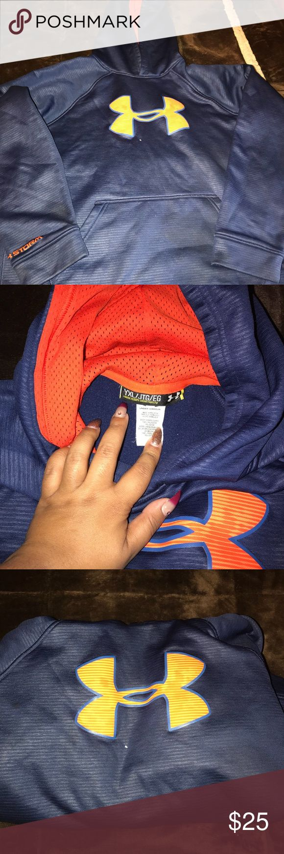 Under Armour Hoodie Navy blue and orange youth Hoodie! Worn a few times, has one very small mark on the Hoodie right under the logo, still good condition. Youth extra large Under Armour Tops Sweatshirts & Hoodies