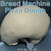 Bread Machine Pizza Dough {Recipe}...in the oven right now. Works REALLY good for mini pizzas :)