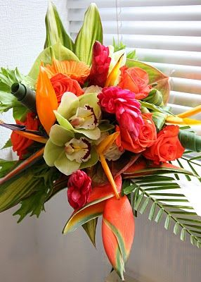 Tropical bouquet/ green cynbidium orchids lobster claw protea red ginger roses and more/  volusiacountyweddings/ www.callaraesfloralevents.com