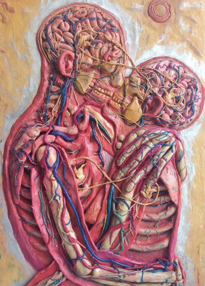 Kiss. Can't remember the artist - Alex Grey? One of my favorites since I was a kid.