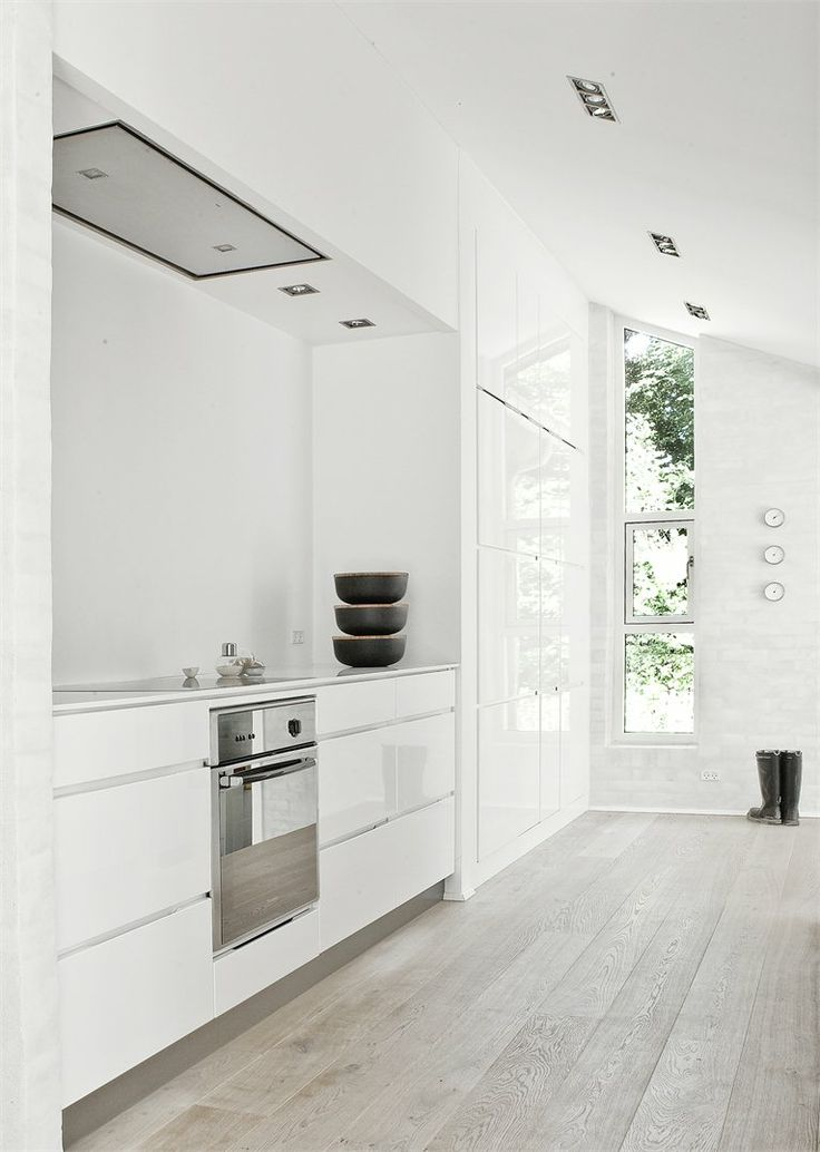 fredensborg-house- grey floor white cabinets