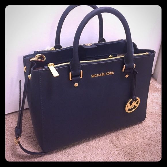 Michael Kors Sutton New with tags Michael Kors sutton medium bag. Bag is navy with gold accents. Has carry and shoulder straps. Just purchased at a Macys store closing and cant return but changed my mind. Comes with dust bag. No trades. Michael Kors Bags