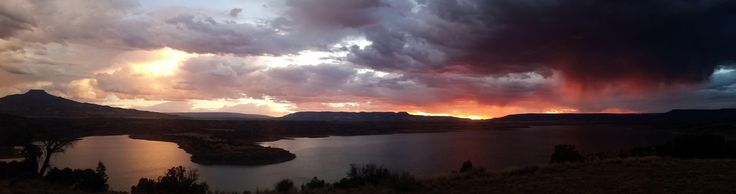 A little thunderstorm rolling over the Piedra Lumbre (Georgia O'Keeffe country) at sunset northern New Mexico [OC] [6656x1760]