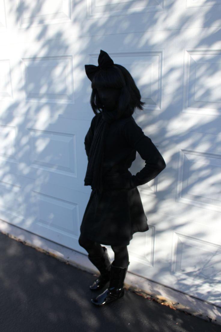 Easiest Halloween Costume Ever - A Shadow!  Black morph suit, whatever black clothes you have in your closet, and a black wig!